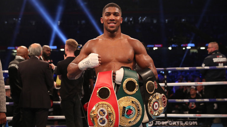 Photo of ANTHONY JOSHUA RETAIN WORLD HEAVYWEIGHT TITLES WITH STOPPAGE WIN OVER CARLOS TAKAM.