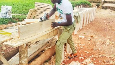 Photo of NIGERIANS COMMEND CORPS MEMBER WHO USED HIS CARPENTRY SKILL TO CONSTRUCT DESKS FOR HIS STUDENTS AT NO COST